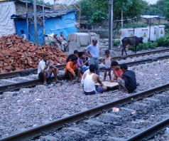 A game of carrom on the tracks